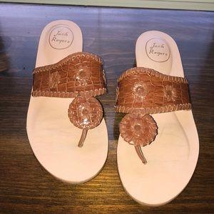 Tan/brown Jack Rogers sandals.